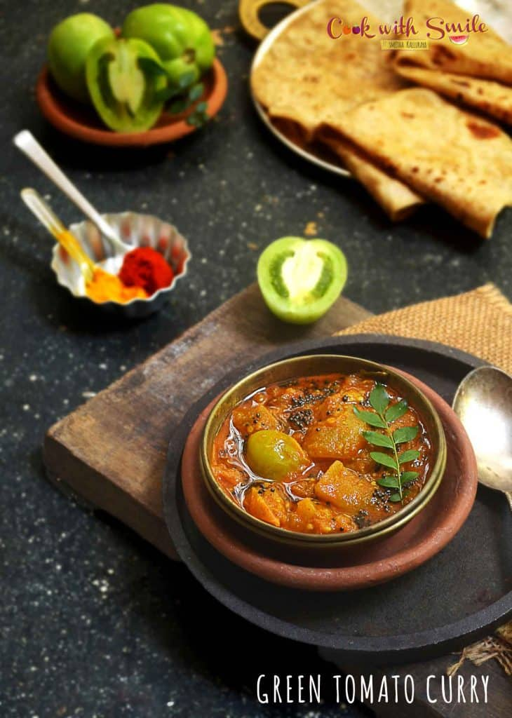 Green Tomato Curry / Kayi Tomato Gojju is an easy and tasty side dish with a perfect blend of spiciness , tartness and a tinge of sweetness